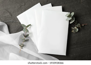 Scented sachets, eucalyptus branches and fabric on black table, flat lay