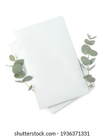 Scented sachets and eucalyptus branches on white background, top view
