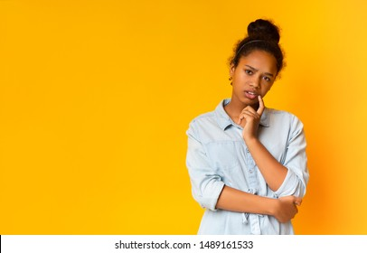 Sceptical african american teen looking suspiciously to camera, having some doubts, copy space