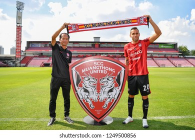 SCG Muangthong United new signing Head Coach Pairoj Borwonwatanadilok (L) and Mario Yurovski during his press conference new coach and player at SCG Stadium on November 22,2018 in Nonthaburi,Thailand