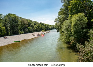 Schaeftlarn,Germany-July 1,2018: Inflatable boats used by families lie on a bank of the Isar river