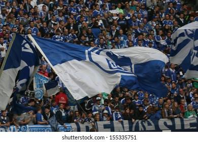 SCHALKE, GERMANY - SEP 21: Schalke 04 Fans celebrating during a Bundesliga match between FC Schalke 04 & FC Bayern Munich, final score 0-4, on September 21, 2013, in Schalke, Germany.