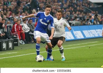 SCHALKE, GERMANY - SEP 21: Julian Draxler (Schalke 04) vs. Rafinha (FC Bayern) during a match between FC Schalke 04 & FC Bayern Munich, final score 0-4, on September 21, 2013, in Schalke, Germany.
