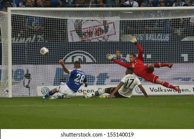 SCHALKE, GERMANY - SEP 21: Manuel Neuer & Jerome Boateng (Bayern) & Adam Szalai (Schalke) during a Bundesliga match between FC Schalke 04 & FC Bayern Munich on September 21, 2013, in Schalke, Germany.