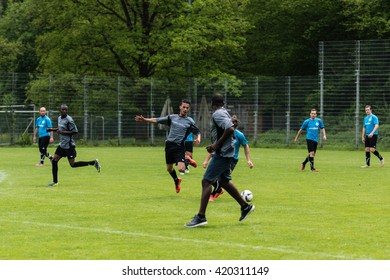 SCHARNHAUSEN, GERMANY - MAY 14, 2016: The team of TSV Scharnhausen is playing a friendly match of soccer against a team of refugees that is residing in a camp in Scharnhausen for 6 months now. Since a