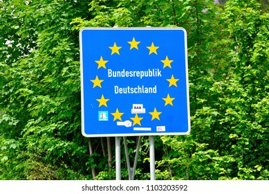 Scharnitz, Austria - May 31, 2018 - Blue EU-state sign announcing the entry to the Federal Republic of Germany on the German - Austrian border near Scharnitz