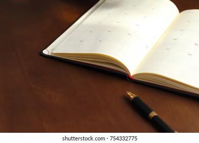 Schedule book and ballpoint pen