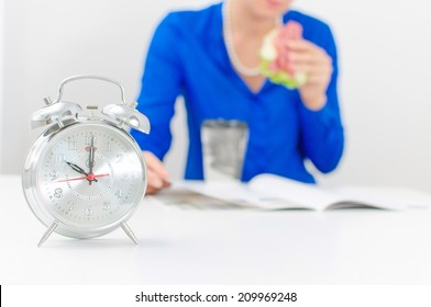 Schedule of the day. Morning. Woman having breakfast.