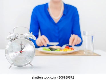 Schedule of the day. Day. Woman having dinner.