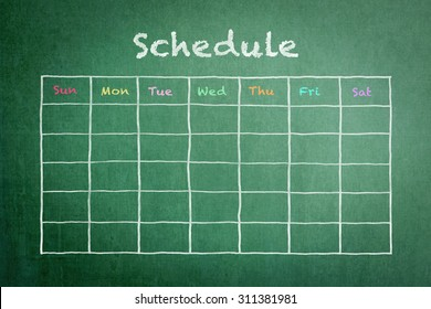 Schedule with grid timetable on green chalkboard background
