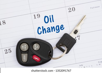 Schedule an oil change message with monthly calendar with car keys and fob