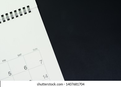 Schedule, reminder and work planning concept, flat lay or top view of white clean calendar on dark black background with copy space.