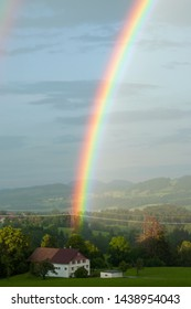 Scheidegg, Germany - June, 21: colorful rainbow over the house. Beautiful rainbow in bavarain countryside