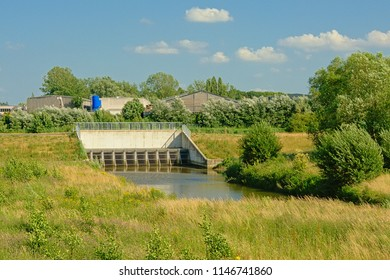 SCHELLEBELLE, BELGIUM, JUNE 20, 2018, Sluice of river Scheldt in Flanders, Belgium. Part of the Sigmaplan which protects Flanders from flooding. Schellebellem, 20 June 2018
