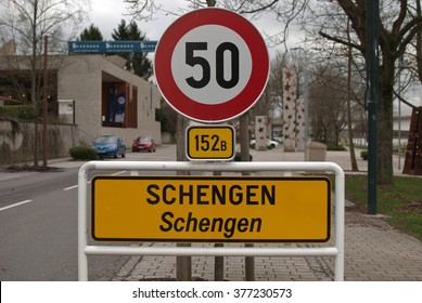 Schengen, Luxembourg - February 15, 2016: Close up of the roadside entrance sign to Schengen and background view of European Museum, near the Schengen Treaty signing location
