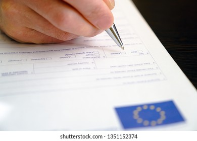 Schengen visa, questionnaire. Hand with pen completing a questionary.