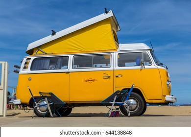 Scheveningen beach, the Netherlands - May 21, 2017: yellow VW combi camper wagen at Aircooled classic car show