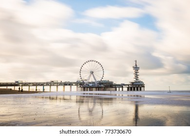 Scheveningen beach on a winter sunny day, Holland. Famous Pier in the background