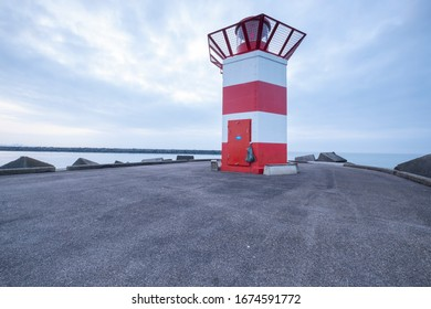 Scheveningen, Februari 18 2019: Scheveningen, The Hague, The Netherlands.Lighthouse at sunset, blue sky with copy space, Scheveningen, The Netherlands