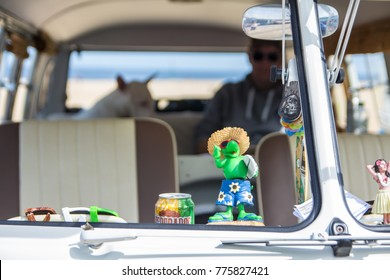 Scheveningen The Hague, the Netherlands - 21 May 2017: interior of VW kombi van at the beach with dog and owner