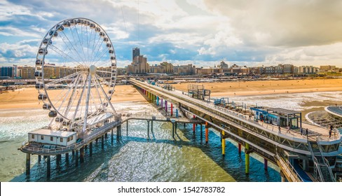 Scheveningen, The Hague, The Netherlands. Ferris wheel and pier at the beach.