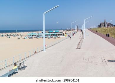 SCHEVENINGEN, THE HAGUE, NETHERLANDS - JULY 3, 2015: Panoramic view of seaside esplanade or promenade and Pier of Scheveningen in The Hague, Netherlands