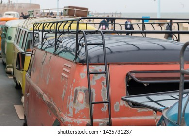 Scheveningen, The Hague, the Netherlands - May 26 2019: row of 1960s classic style VW Transporter combis at  beach with  roof rack closeup