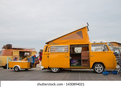 Scheveningen, The Hague, the Netherlands - May 26 2019: 1960s style VW classic combi with trailer parked at Scheveningen beach during aircooled motor show