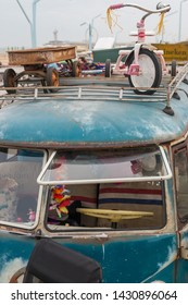 Scheveningen, The Hague, the Netherlands - May 26 2019: 1960s classic style VW Transporter combi at  beach with  roof rack closeup front view of flip up windscreen