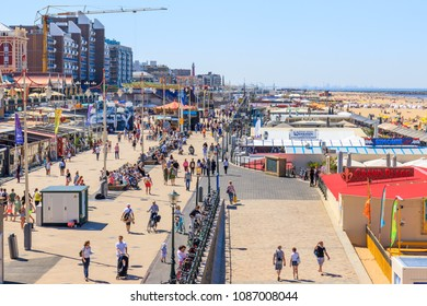 Scheveningen, Netherlands - May 07, 2018: People Walking At Scheveningen On A Sunny Day