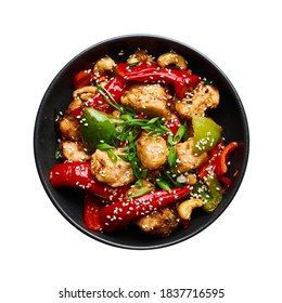 Schezwan Chicken or Dragon Chicken in black bowl isolated on white background. Szechuan Chicken is popular indo-chinese spicy dish with chilli peppers, chicken and vegetables.