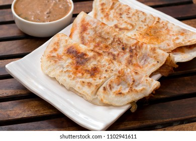 Schezwan dosa is a twist to the regular South Indiandosa in Chinese cuisine.Stir fried vegetables and sachewzan sauce is used asa filling to the dosa.
