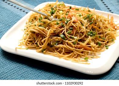 Schezwan veg noodles is a spicy and tasty stir fried Hakka noodles with schezwan sauce and veggies.