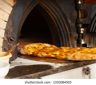 Schiacciata all'olio is one of Tuscany's top bakery treats. It's a type of flat bread made with flour, water, yeast, salt and olive oil.