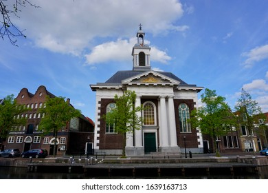 Schiedam, The Netherlands - April 23 2018: The Havenkerk along the water of the Lange Haven was originally built for the growing Catholic community of Schiedam