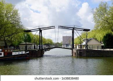 Schiedam, The Netherlands - April 26 2018: The Willemsbrug is a double drawbridge between the Nieuwe Haven and the Westerhaven of Schiedam