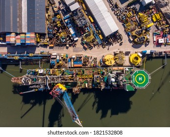 Schiedam, The Netherlands - MARCH 2020: Aerial Shot of the Harbour with a Giant Crane Vessel in the Nieuwe Maas from the quay of the Voorhaven of Schiedam