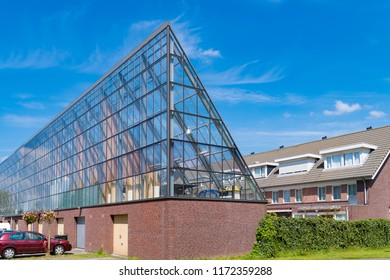 SCHIEDAM, NETHERLANDS - MAY 6, 2017: Transparent garage building with glass roof