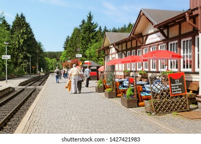 Schierke, Saxony-Anhalt / GERMANY - May 26 2019: trainstation in village Schierke of historical locomotive up to Brocken Peak. People waiting for the train to arrve.