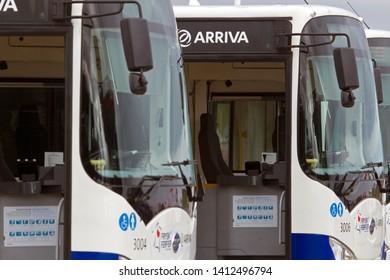 Schiermonnikoog, the Netherlands - May 29, 2019: Arriva buses at the port of Schiermonnikoog