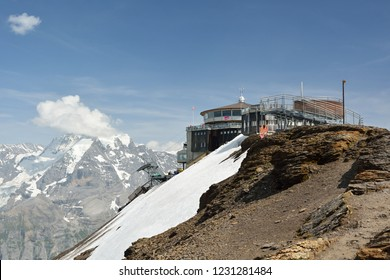 Schilthorn, Switzerland - July 4, 2015: Top cablecar station on top of Schilthorn peak with beautiful views on Bernese Alps in canton of Bern, Switzerland during summer 2015