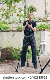 Schioss Wartholz, Austria - June 14, 2014: Professional photographer videographer customizes equipment for shooting a wedding, holiday or event