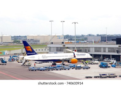 SCHIPHOL AIRPORT, AMSTERDAM, NETHERLANDS - March 20. Boeing 757 airplane of Icelandair waits at the gate for departure on March 20, 2017 in Schiphol Airport.