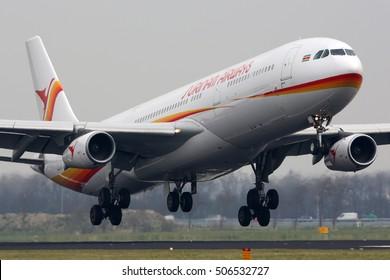 SCHIPHOL, AMSTERDAM, NETHERLANDS - APRIL 2, 2016: Airbus A340-313 PZ-TCR of Surinam Airways landing at Schiphol international airport.