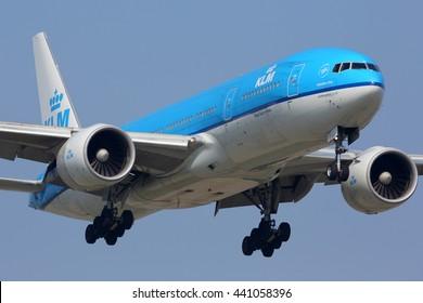 SCHIPHOL, AMSTERDAM, NETHERLANDS - APRIL 3, 2016: Boeing 777-200 of KLM Royal Dutch Airlines landing at Schiphol international airport.