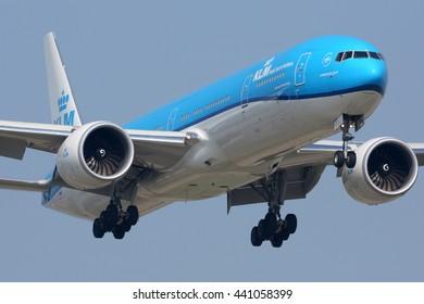 SCHIPHOL, AMSTERDAM, NETHERLANDS - APRIL 3, 2016: Boeing 777-300ER in new color scheme of KLM Royal Dutch Airlines landing at Schiphol international airport.