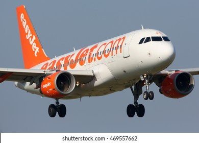 SCHIPHOL, AMSTERDAM, NETHERLANDS - APRIL 3, 2016: Airbus A319-111 G-EZED of EasyJet Airlines landing at Schiphol international airport.