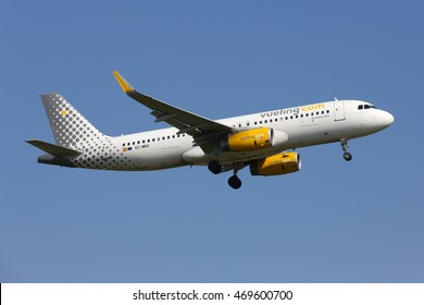 SCHIPHOL, AMSTERDAM, NETHERLANDS - APRIL 3, 2016: Airbus A320-232(WL) EC-MBS  of Vueling Airlines landing at Schiphol international airport.