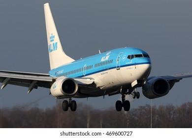 SCHIPHOL, AMSTERDAM, NETHERLANDS - APRIL 3, 2016: Boeing 737-7K2 PH-BGF of KLM Royal Dutch Airlines landing at Schiphol international airport.