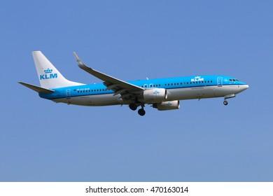 SCHIPHOL, AMSTERDAM, NETHERLANDS - APRIL 3, 2016: Boeing 737-8K2 PH-BXB of KLM Royal Dutch Airlines landing at Schiphol international airport.